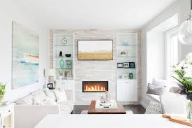 decorate living room with fireplace. Feature Wall Ideas Living Room With Fireplace And Modern White Interior Design Using Cabinet Decorate