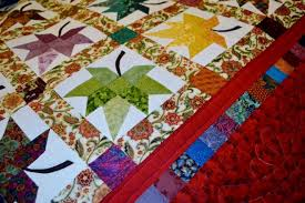 """Much More Than Quilts at Amish Quilt and Holiday Craft Show - Door ... & """"Autumn Splendor"""" is just one of more than 90 handmade Amish quilts that  will available for sale at the Amish Quilt and Holiday Craft Show.  Submitted. Adamdwight.com"""