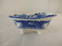 There are a handful of ways to get clean while you're out there on the road. Past Times Blue And White Porcelain Bath Tub Figurine Filled With Glass Coins Ebay