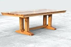 trestle salvaged wood dining table image 0 salvaged wood weathered concrete trestle round dining table