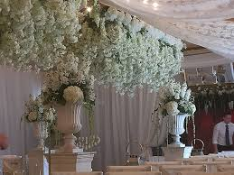 chandelier decorations for wedding inspirational hanging wisteria for a wedding walkway with urns and plinths