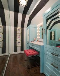 long kids closet with white and black striped walls and ceiling