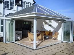 opened bi folding doors glass garden room design
