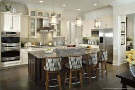 fine kitchen pendant lighting fixtures over island with ivory colored cabinets as well as four bar stools white wall also parquet flooring