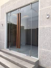 glass door furniture. Vestibule Doors - Frameless Glass With Natural Wood Handles. Door Furniture M