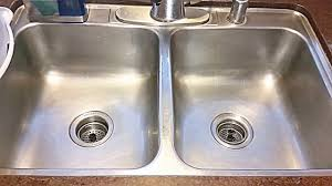 clean stainless steel sink with hydrogen peroxide baking soda