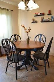 this table chair set has been refinished like i want black base with stained top table but i d prefer the black chairs with stained seats over all black i