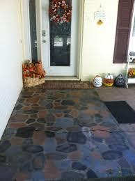 spray painted faux stones on concrete patio