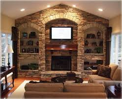 stone wall with fireplace and built ins living room