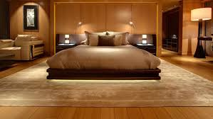 superyacht stateroom with luxury carpet inlay set in hardwood flooring
