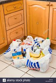 Kitchen Floors Uk Shopping Bags On A Kitchen Floor England Uk Stock Photo