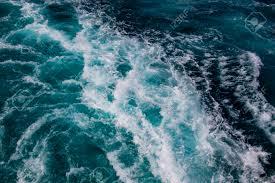 Ocean Surface Sea Foam On Blue Ocean Background