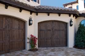splendorous rustic garage doors outdoor wall sconces with decorative flower also rustic wood