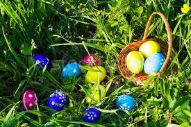 Easter Egg Hunt On Green Grass Background Stock Photo