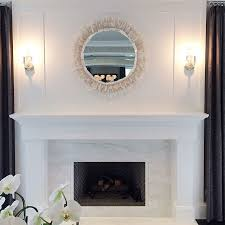 stunning living room fireplace boasts a white marble surround and a contrasting gray herringbone firebox under