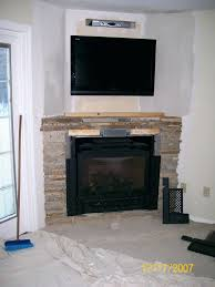 smlf hanging flat screen tv above gas fireplace installing over panel corner fireplaces and finally unused
