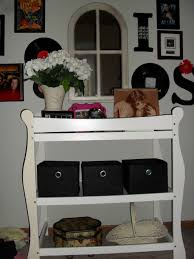 Old changing table becomes extra storage for bedroom with mirror from  Goodwill