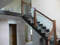 internal steel staircase with channel stringers for glass and wooden barade