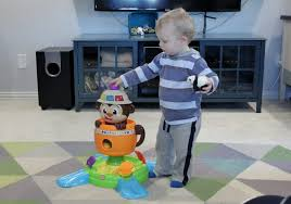 This Bright Starts Hide \u0027n Spin Monkey is a great gift for 12-18 Month Old Gift Guide   One Hangry Mama