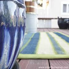 after you paint a rug show it off on your porch or deck