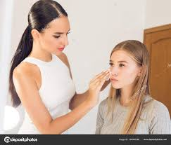 professional makeup artist to do new style with a beautiful model stock photo