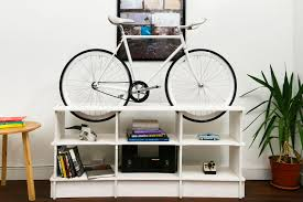 storage furniture for small spaces. bike storage furniture a double duty bookcase for small spaces
