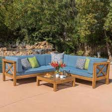 brava teak finish 4 piece wood outdoor sectional set with blue cushions