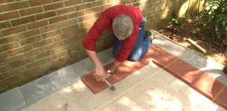 how to lay brick pavers on a concrete