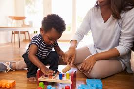 1 year old boy developing through play with toys