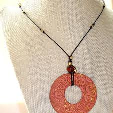 eco friendly aromatherapy handmade clay pendant with swirl design bead accents on black linen cord personal