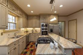 elegant cabinets lighting kitchen. Elegant Kitchen Design With Two Tone Cabinets And Under Cabinet Lighting Plus Kraus Sinks Brizo Faucets Quartz Countertop Also Pendant