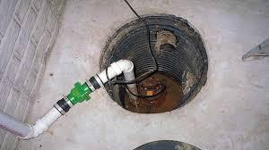 a sump pump in a basement floor