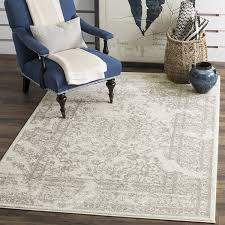 Amazon.com: Safavieh Adirondack Collection ADR101B Ivory and Silver  Oriental Vintage Distressed Area Rug (8' x 10'): Kitchen & Dining