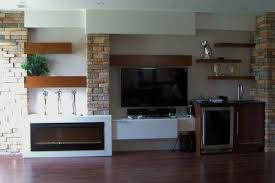 contemporary design incorporates an electric fireplace a home theatre and bar area featuring floating cherrywood