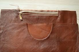 back side of the leather tote bag with zipper