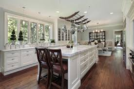 White Kitchen Dark Wood Floors Gourmet Kitchens And Cabinets Hannegan Construction