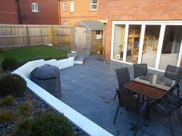 Lilybud Gardens By Design Limestone Paving With White Rendered Retaining Walls