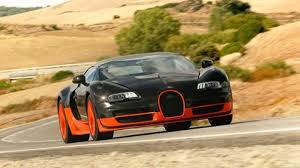 The super sport's flat, elongated silhouette is immediately recognizable. Bugatti Veyron 16 4 Super Sport 2011 Review Car Magazine