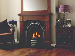 arched cast iron fireplace set in victorian style dark wood mantel