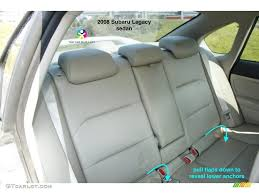 were replaced by a large fabric flap that you have to unvelcro and pull down to reveal the lower anchors otherwise the back seat is the same as 2007