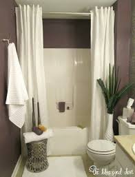 apartment bathroom. hang a second shower curtain to make your tub seem extra luxurious. apartment bathroom