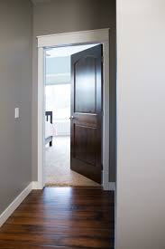interior doors white trim and door topper paired with a two panel arch top door prefinished macchiato bayer built woodworks inc