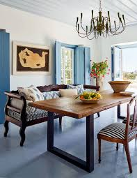 the blue and white dining room in this greek island home is balanced by warm wood antiques house tour via coco kelley