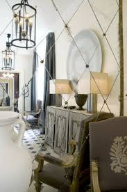 French foyer - antiqued mirror tiles hung on the diagonal...or is that
