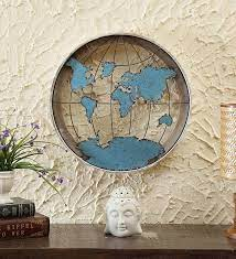metal round world map in blue wall