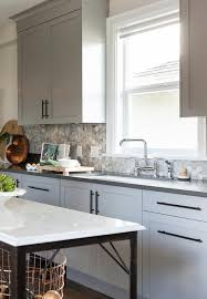 gray kitchen cabinets with bronze pulls