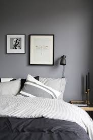 the mix of light grey stripe with solid dark grey bedding