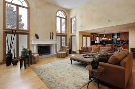 light wood floor living room floors and the textured walls unify this space with their light charm impression living room lighting ideas