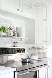 decorating with glass canisters in the kitchen photo via holly mathis anderson