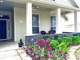 Decorations:Extraordinary Front Porches Design With Beautiful Purple Flower  And Relaxing Black Wicker Chair Extraordinary